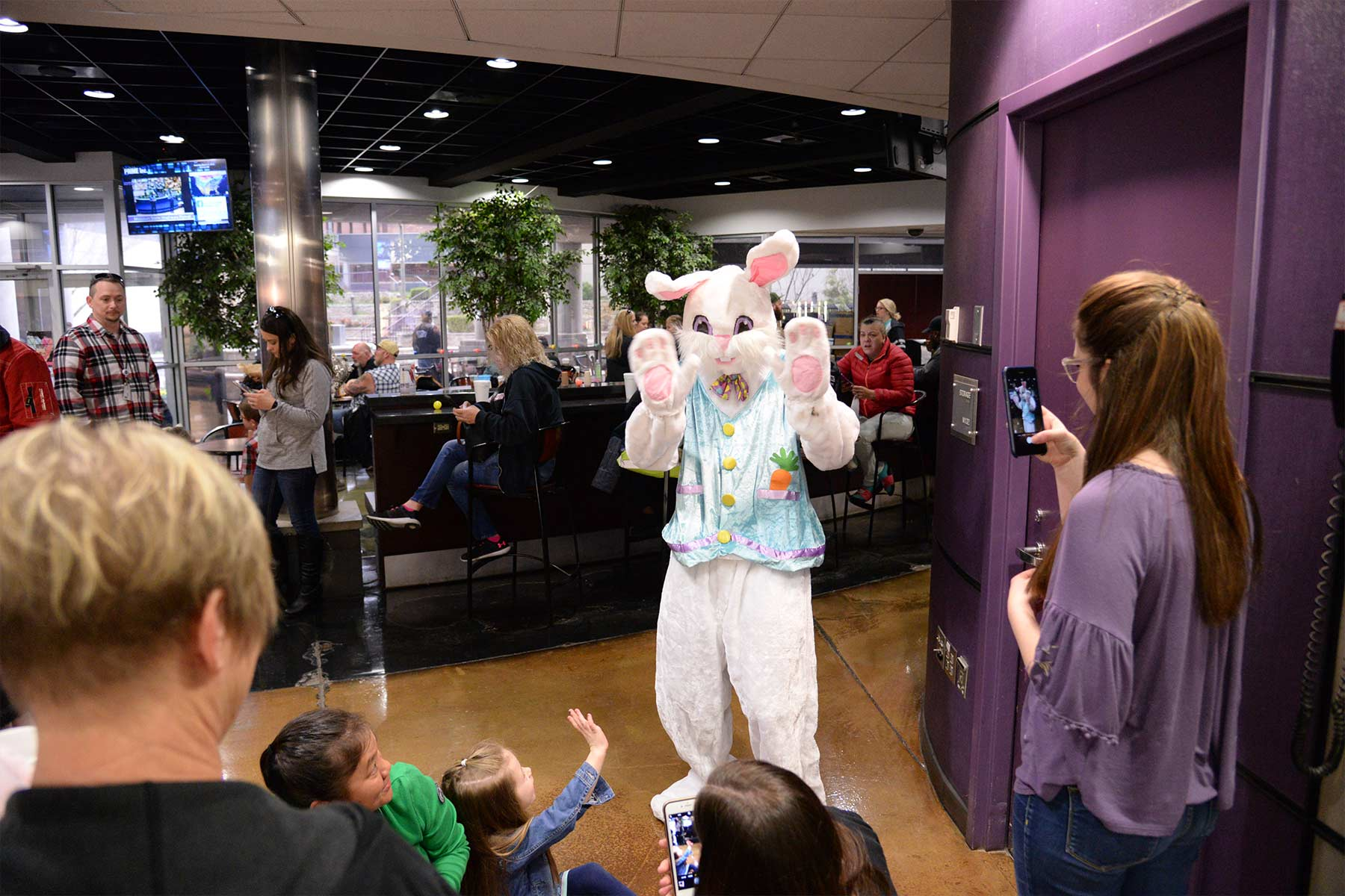 The Easter bunny greeting children and their parents during Prime Inc.'s annual Easter Egg Hunt.