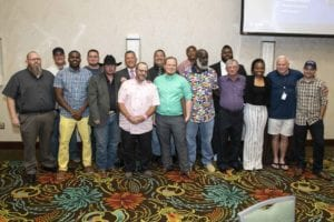 A group of Prime Inc. truck driving instructors posing for a picture at the Top Instructor and Trainer banquet.